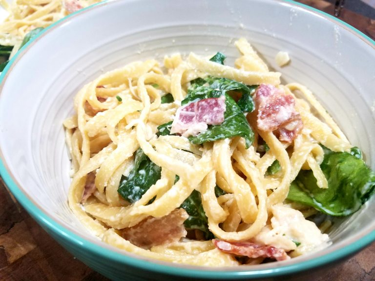 One of my families favorite pasta dishes. The blend of spinach, chicken and bacon mixed with creamy sauce is amazing.
