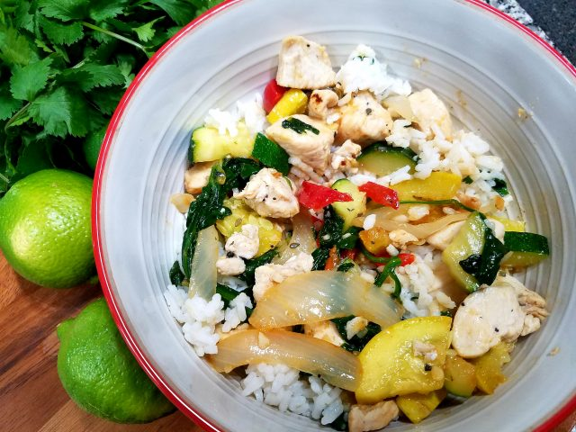 The amazing blend of chicken and vegetables topped on a bed of cilantro lime infused rice.